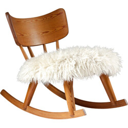Swedish rocking chair in pinewood and sheepskin - 1940s
