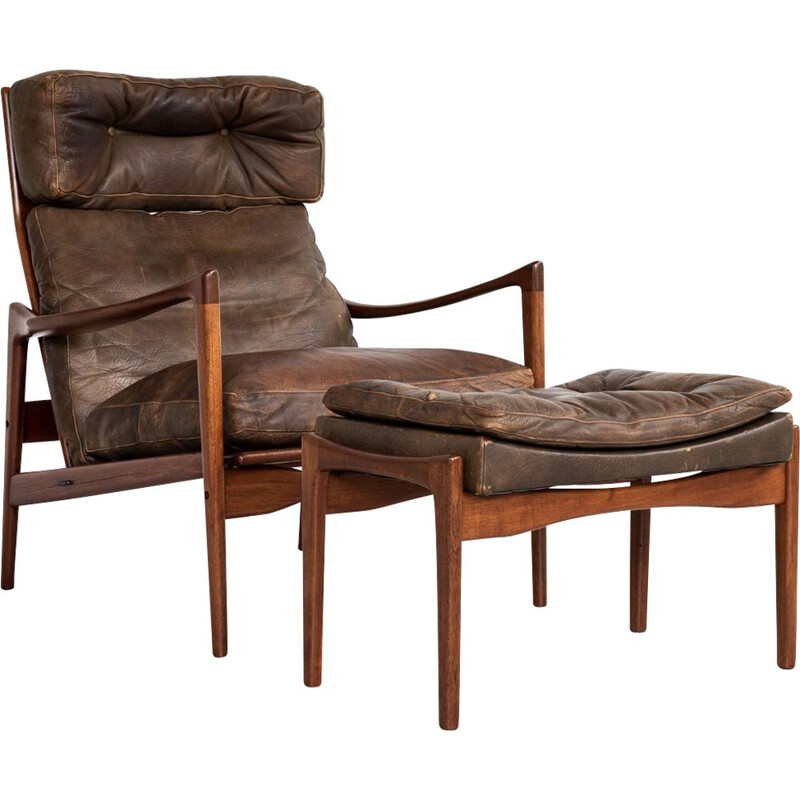 Vintage  easy chair and ottoman in teak and leather by Ib Kofod Larsen