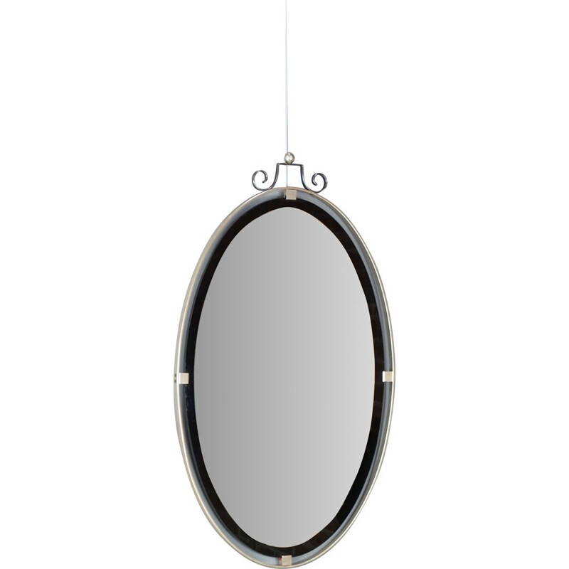 Vintage oval mirror suspended in chrome