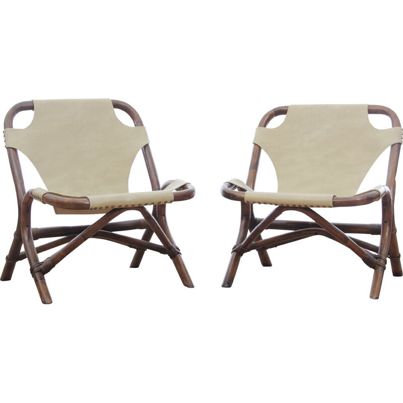 Pair of vintage rattan and imitation leather armchairs