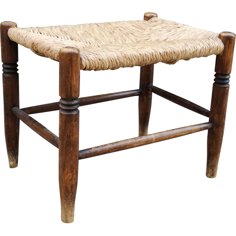 Vintage stool made of wood and woven straw
