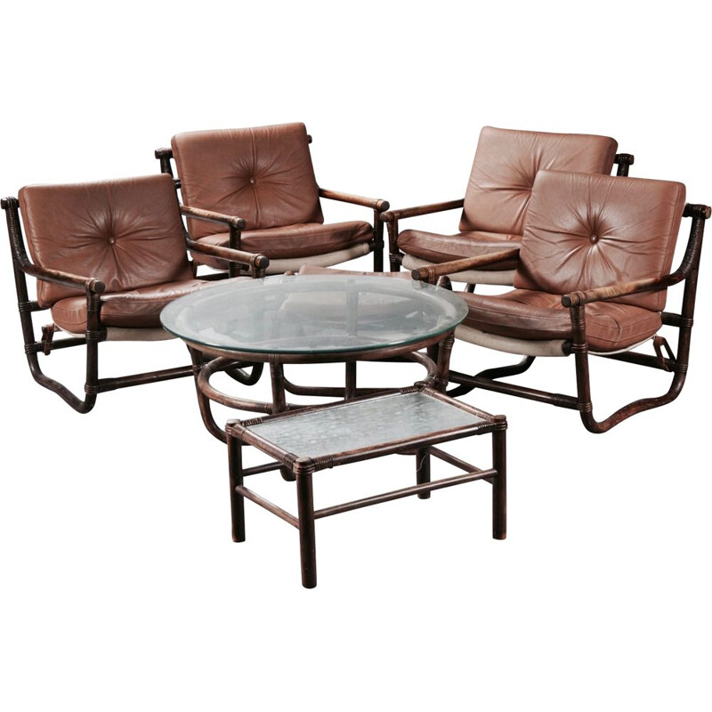 Set of 7 pieces 4 armchairs 1 ottoman 2 coffee tables rattan and leather 1950.