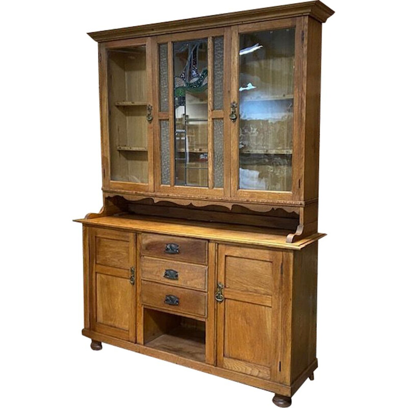 Early 20th century English china cabinet in blond oak