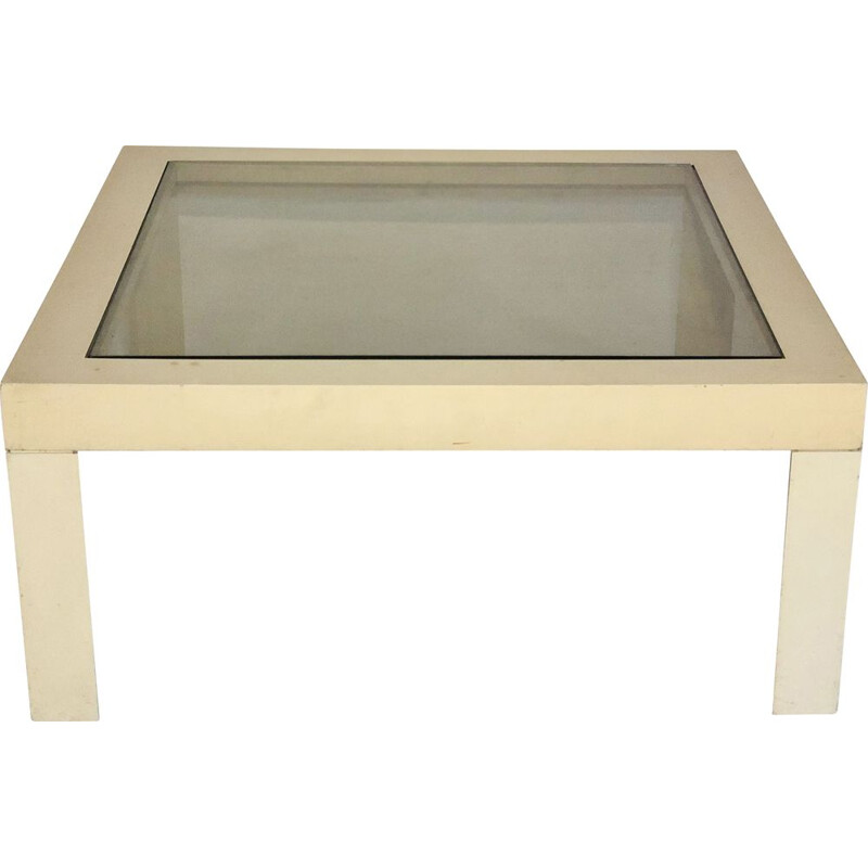 White plastic coffee table with glass top