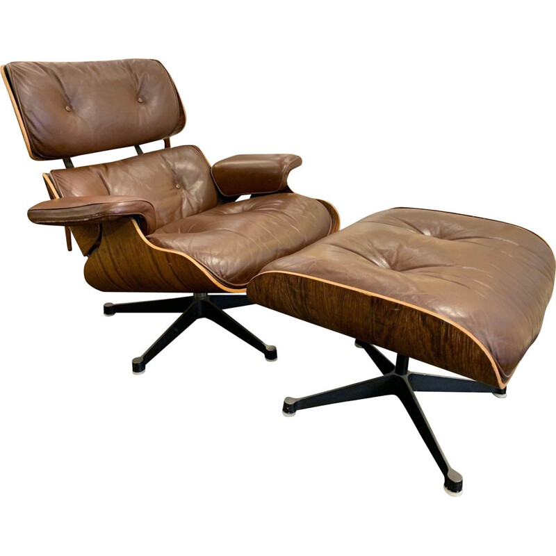 Brown leather lounge chair and Ottoman by Charles and Ray Eames