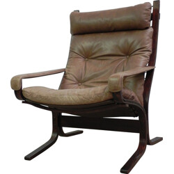 """""""Siesta"""" lounge chair in wood and brown leather - 1960s"""