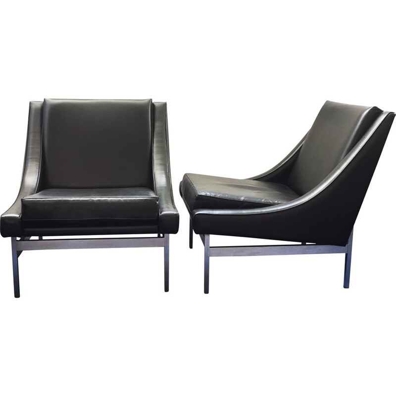 Pair of vintage low armchairs in black leather and chromed metal 1970
