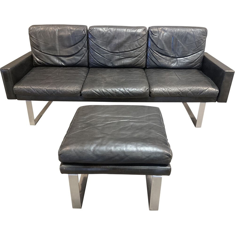 Vintage black leather sofa and its ottoman 1960