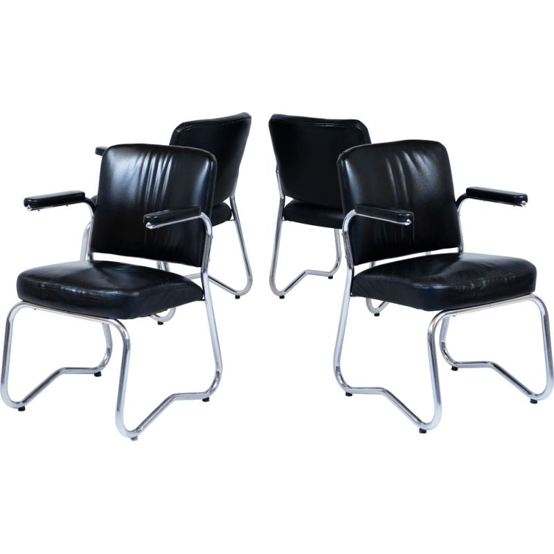 Suite of 4 vintage Bauhaus leather and skai chairs
