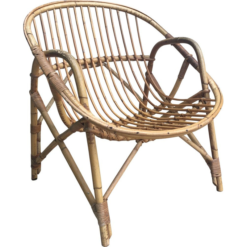 Vintage armchair Coquille in Rattan