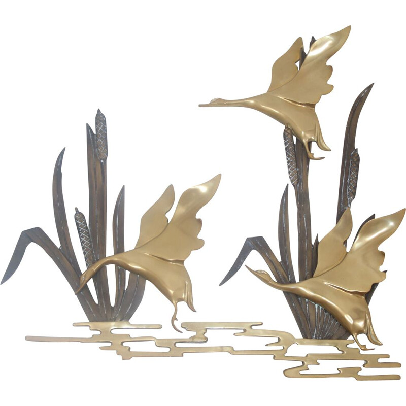 Vintage Flying ducks from the reeds made of copper