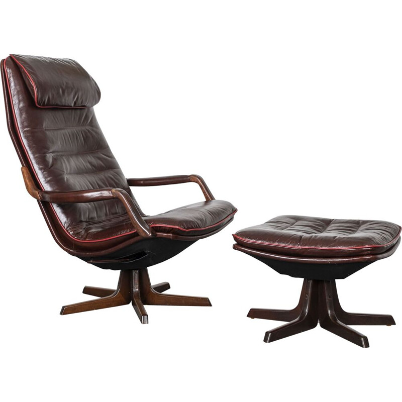 Vintage Reclining leather chair with matching foot stool. By Berg Furniture, Denmark. 1970s