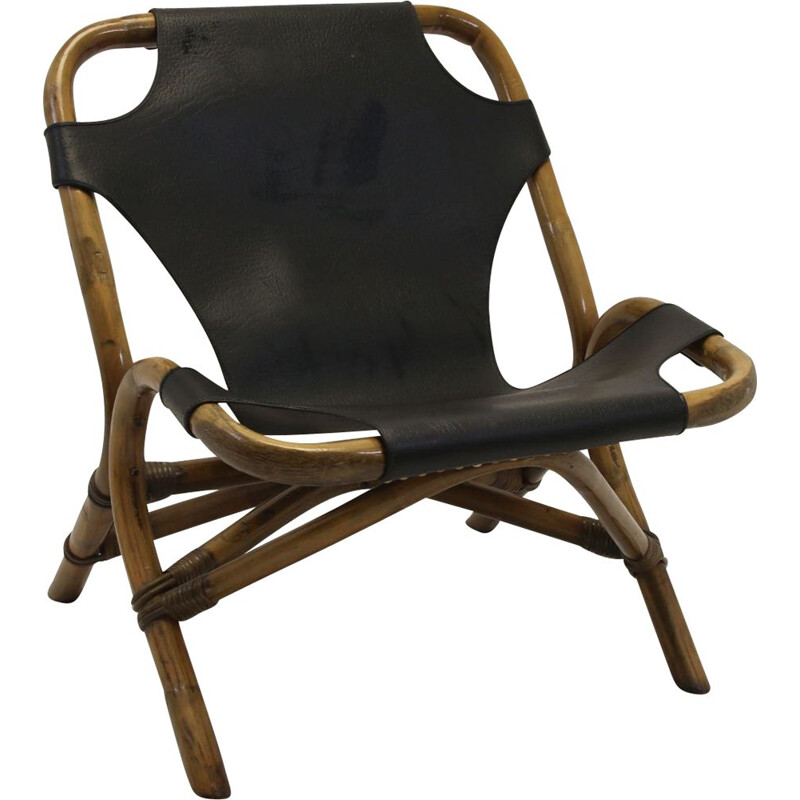 Vintage Rattan relax chair with black leather seat