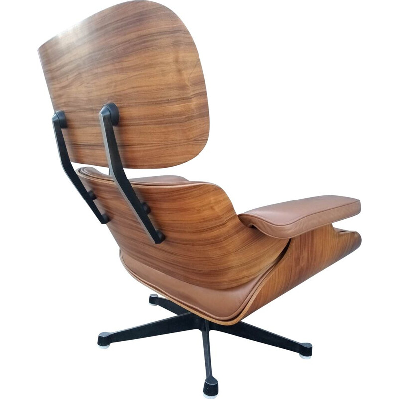 Lounge chair and brown ottoman by Charles Eames for Mobilier International 1990