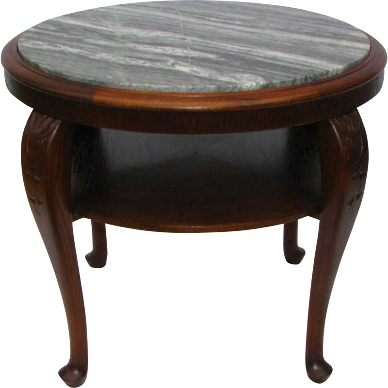 Vintage table with a marble top on bent legs