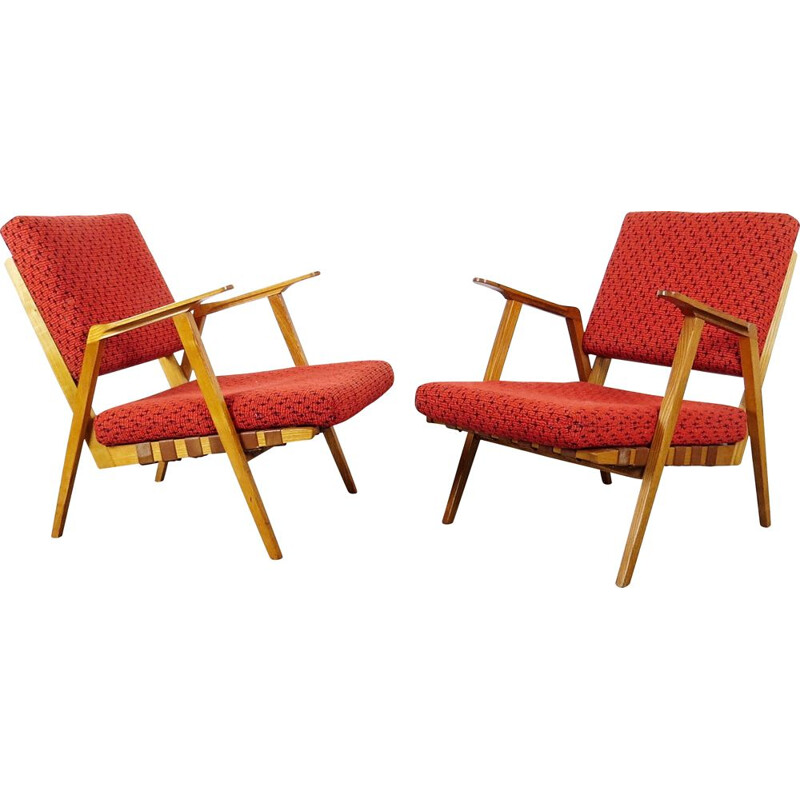 Vintage red armchairs circa 1960