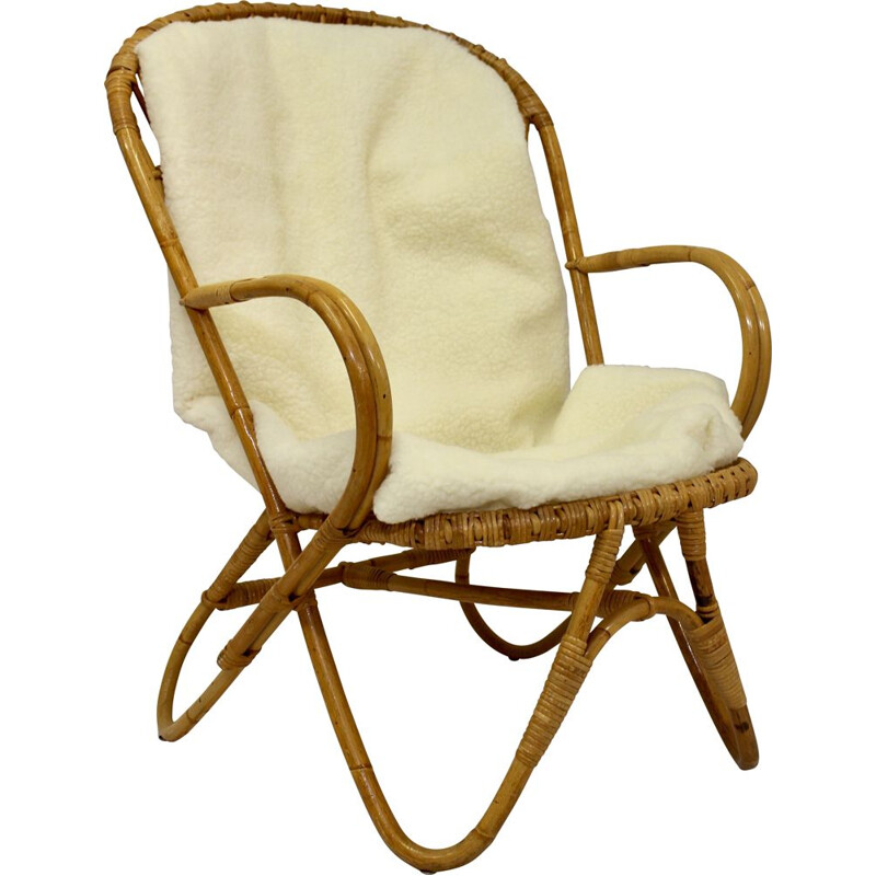 Vintage rattan armchair with butterfly feet 1960