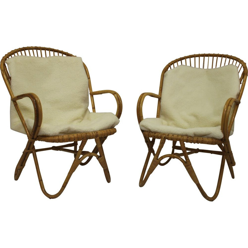 Pair of vintage rattan armchairs with butterfly legs 1960
