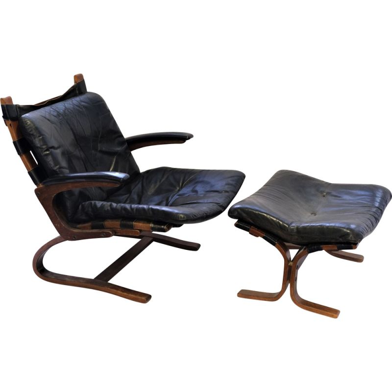 Vintage armchair Elsa &Nordahl Solheim and its ottoman for Rybo Rykken &Co in black leather 1960
