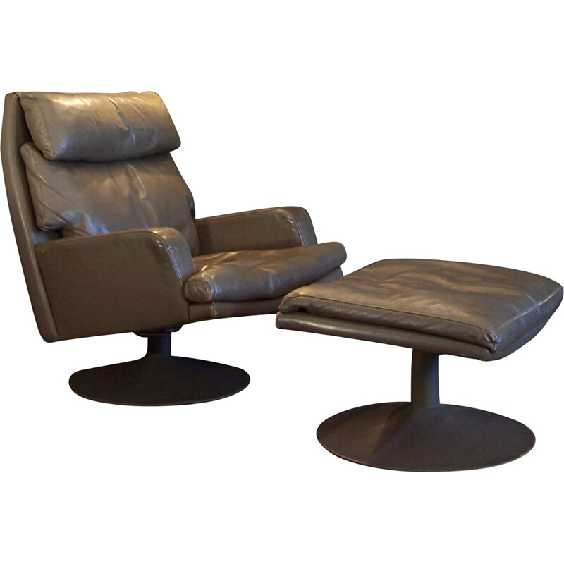 Tall swiveling armchair in leather with its ottoman - 1960s