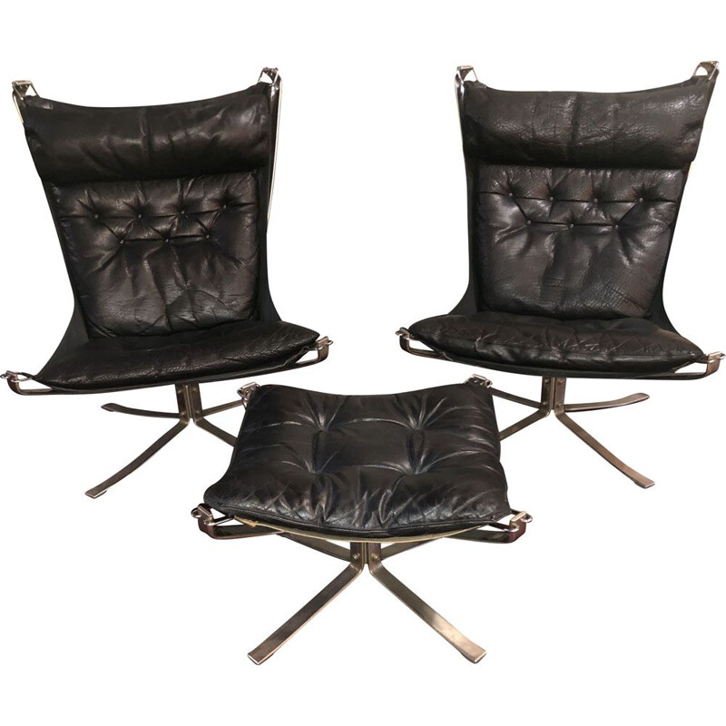 Pair of vintage black Falcon armchairs with ottoman