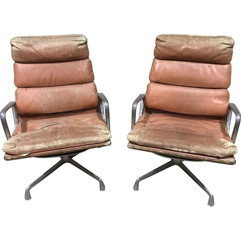 Pair of vintage armchairs by Charles and Ray Eames in leather and aluminium 1960s