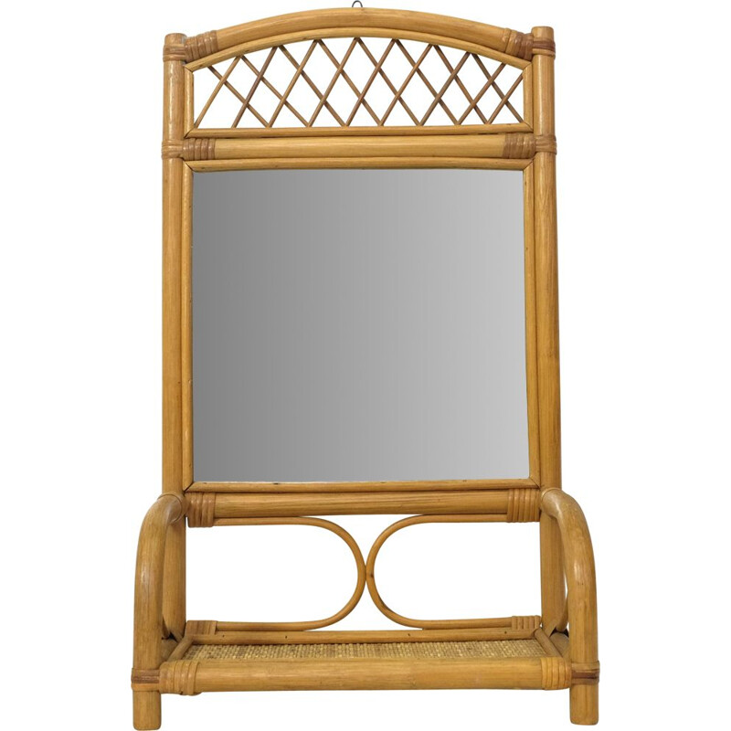 Vintage mirror and its rattan shelf 1970s