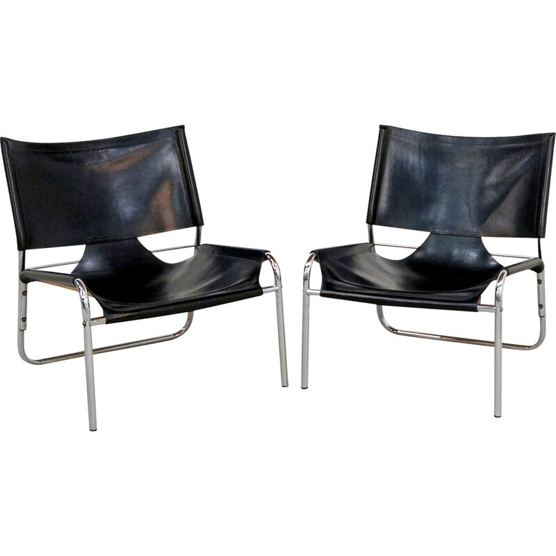 Pair of Mid-century easy chairs in black leather and chrome 1970s