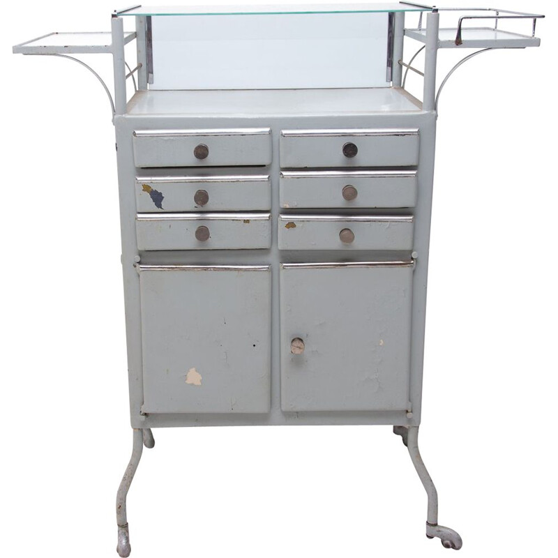 Vintage metal apothecary cabinet on wheels 1960s