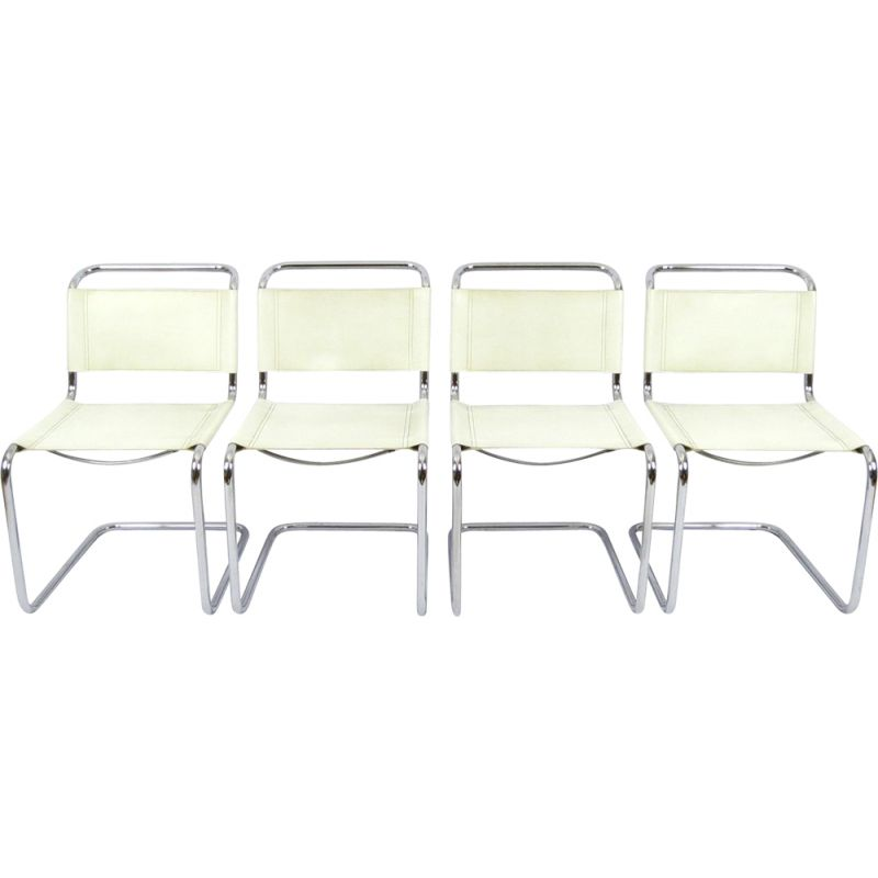 Set of 4 vintage chromed metal and skai chairs 1980s