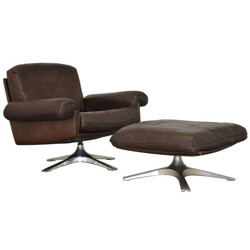 "De Sede ""DS-31"" armchair in dark brown learther and ottoman - 1970s"