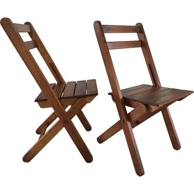 Pair of vintage woodstamped folding chairs