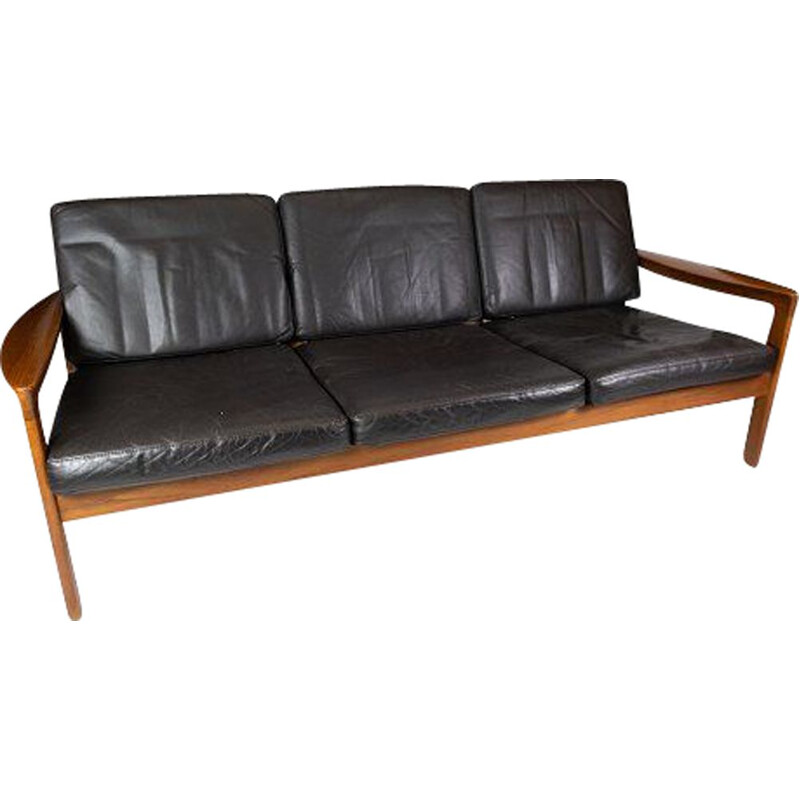 Vintage teak three seater sofa and upholstered with black leather by Arne Vodder 1960s