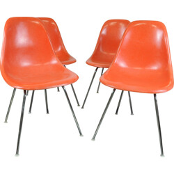 "Set of 4 Vitra ""DSX"" chairs in orange fiberglass, Charles & Ray EAMES - 1970s"
