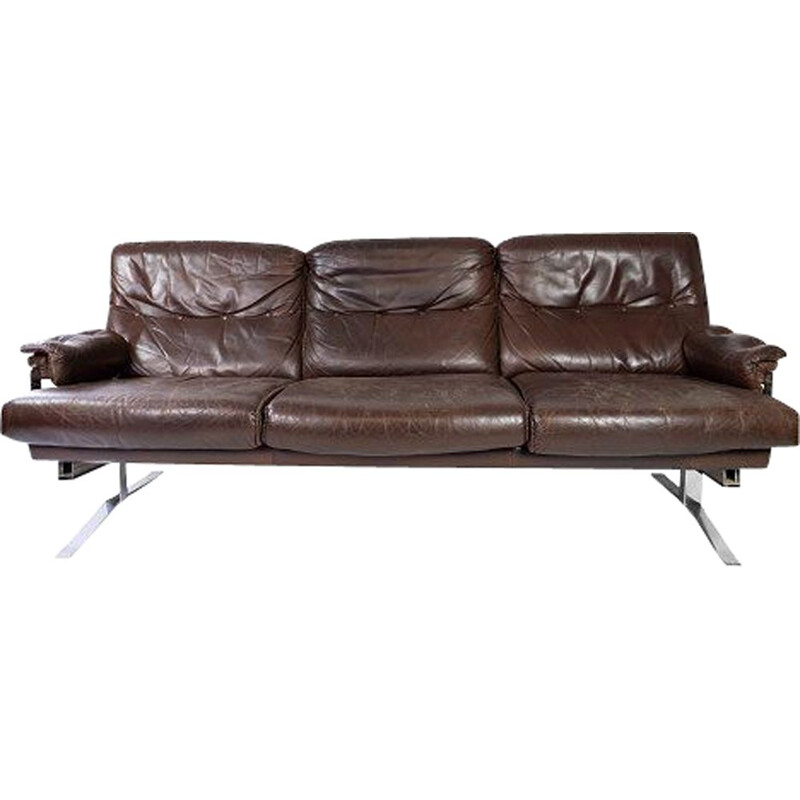 Vintage 3 seater sofa upholstered in brown leather and metal frame by Arne Norell 1970s