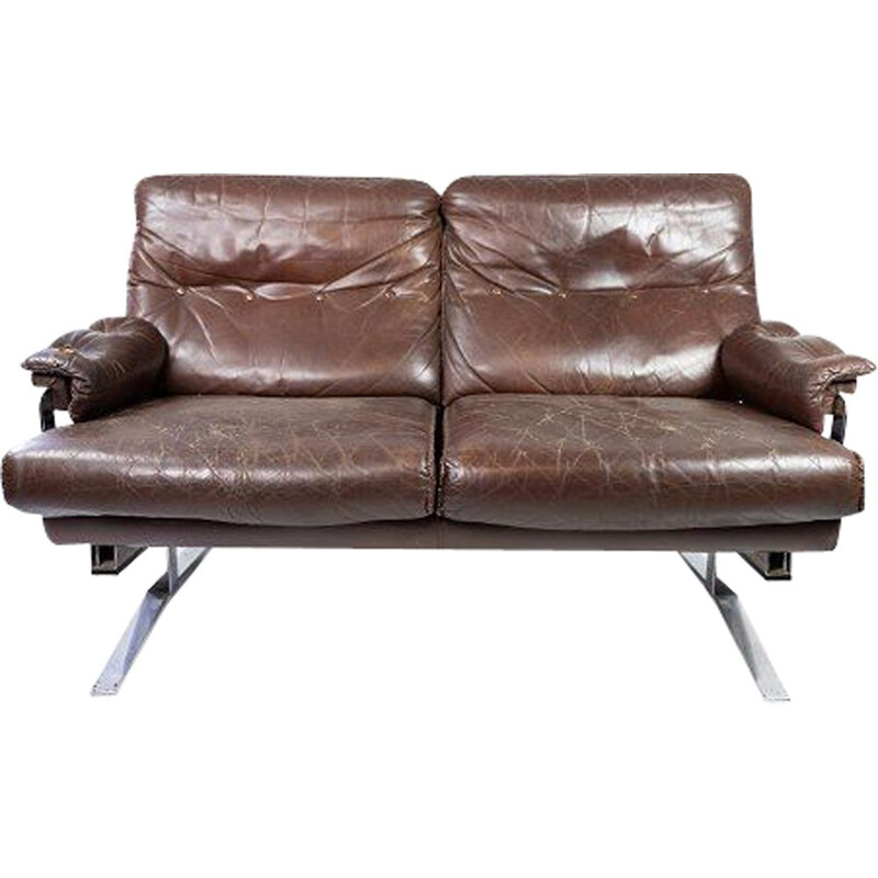 Vintage 2 seater sofa upholstered in brown leather and metal frame by Arne Norell 1970s
