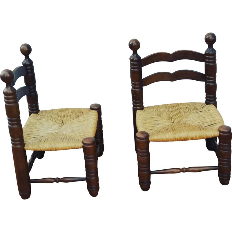 Pair of vintage side chairs by charles Dudouyt