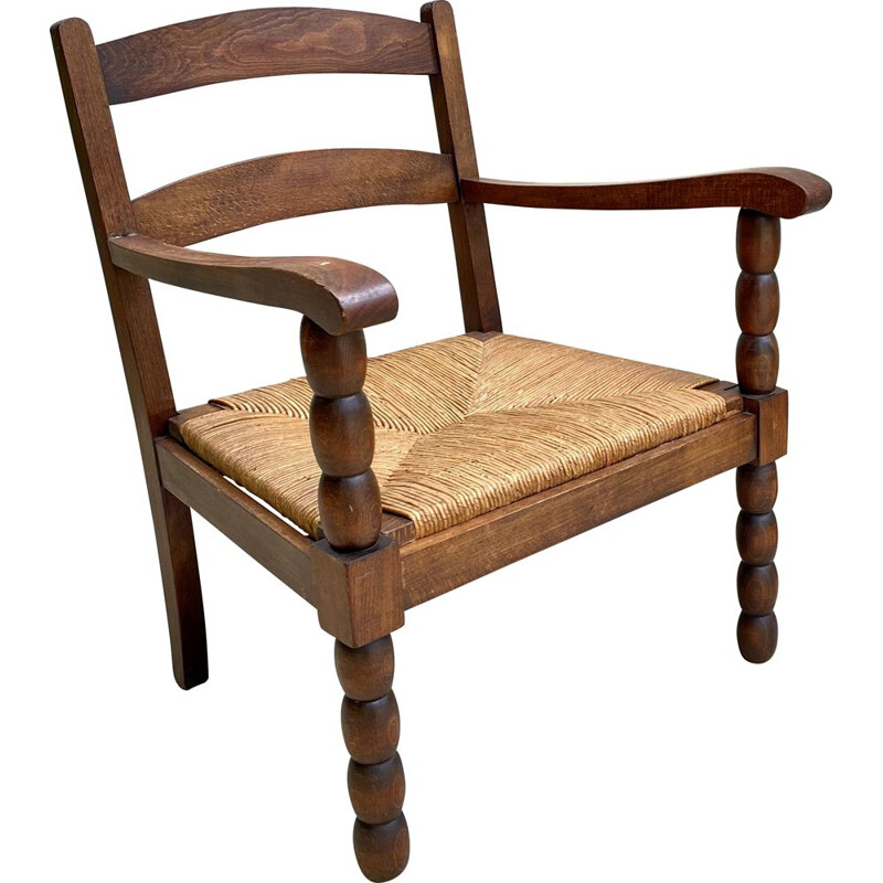 Vintage straw armchair by Charles Dudouyt