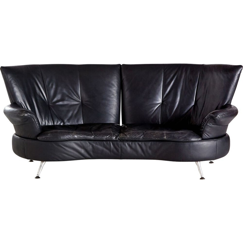 Two-seater black vintage leather sofa