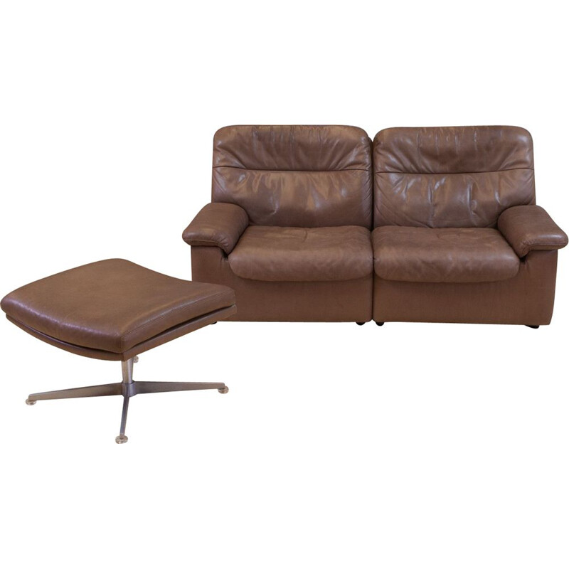 Set of vintage brown leather sofa and ottoman by De Sede