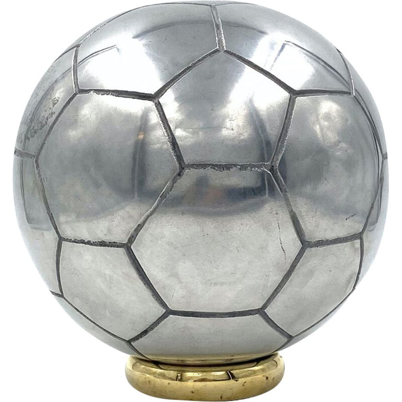 Vintage sculpture of a football in polished aluminium