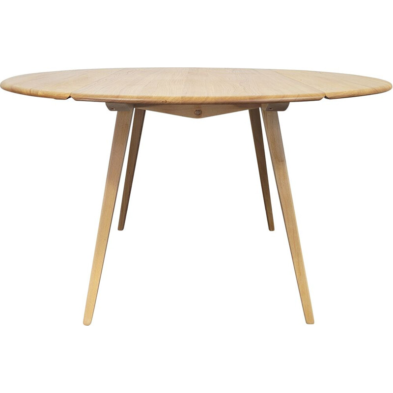 Vintage round table with wooden top by Ercol, 1960