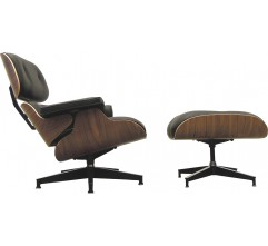 """Herman Miller """"Lounge chair"""" armchair with its ottoman in black leather, Charles & Ray EAMES - 2000s"""