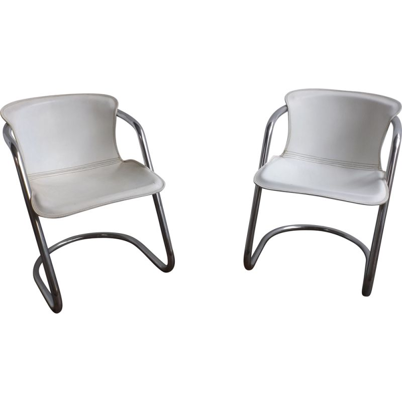 Pair of vintage white leather chairs by Metaform
