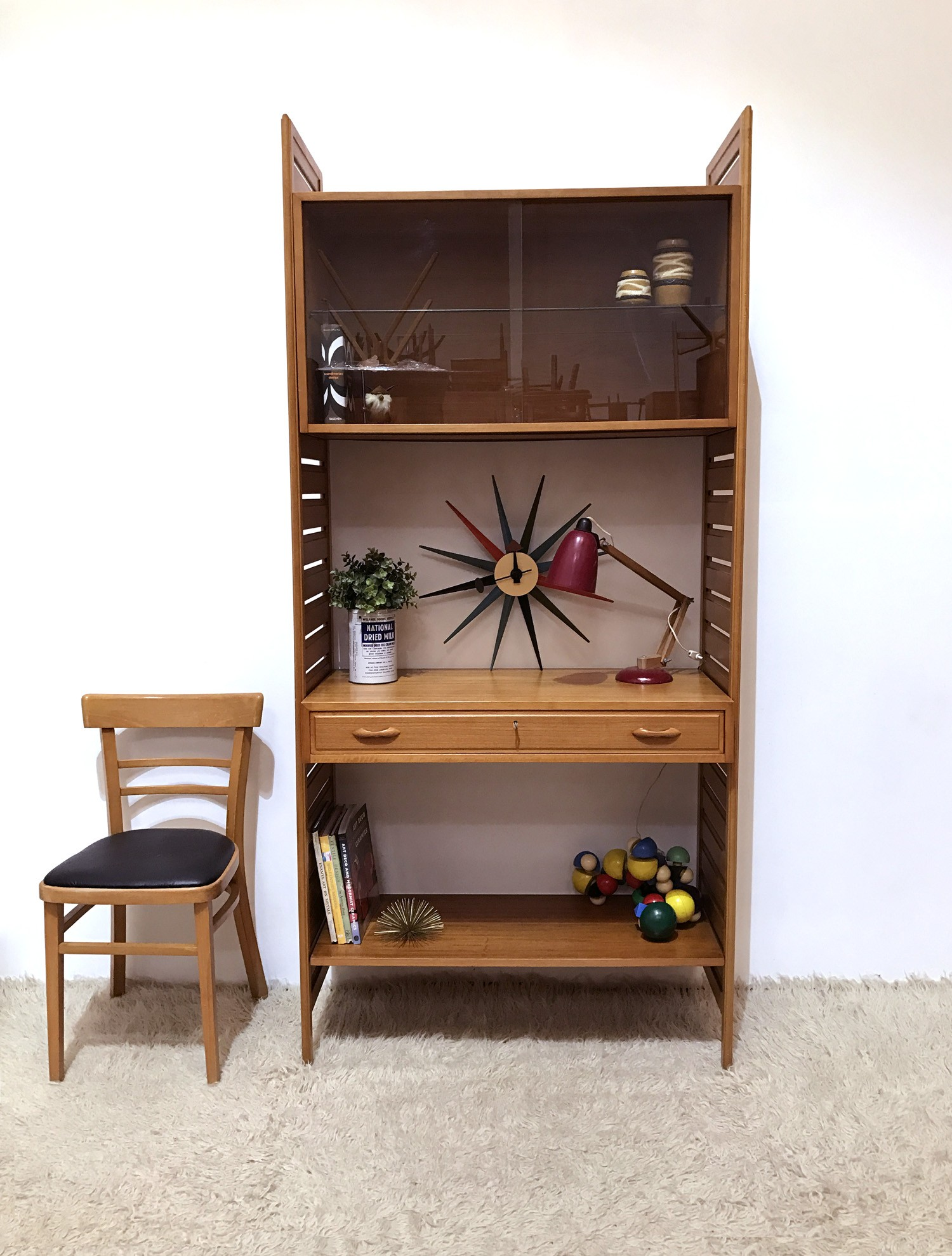Modular Staples wall shelving system in teak - 1960s