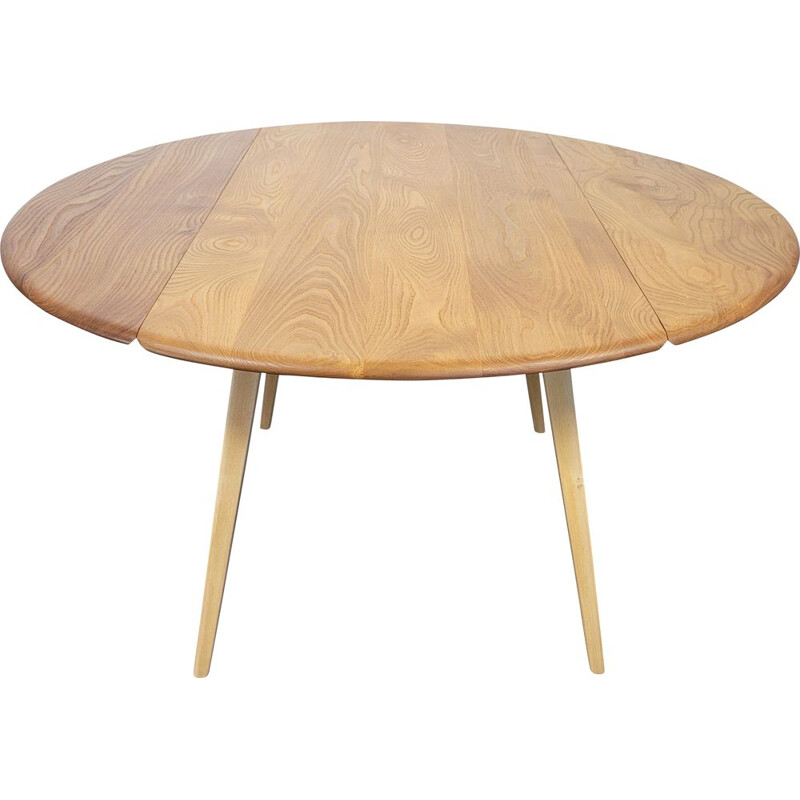 Vintage round elmwood and beechwood drop leaf dining table by Ercol, 1960s