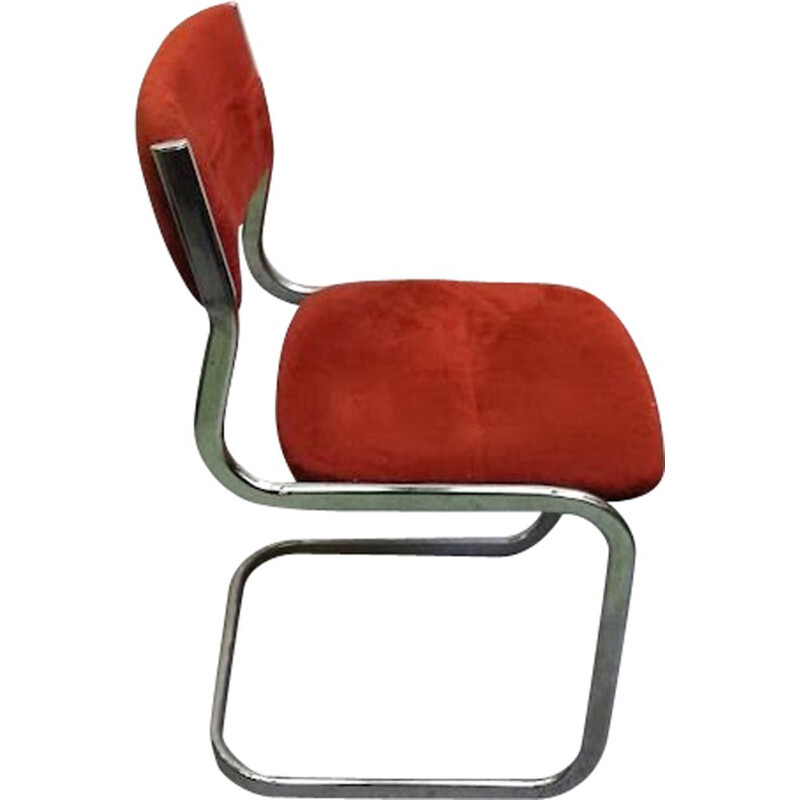 Vintage chair made of burgundy fur and aluminium
