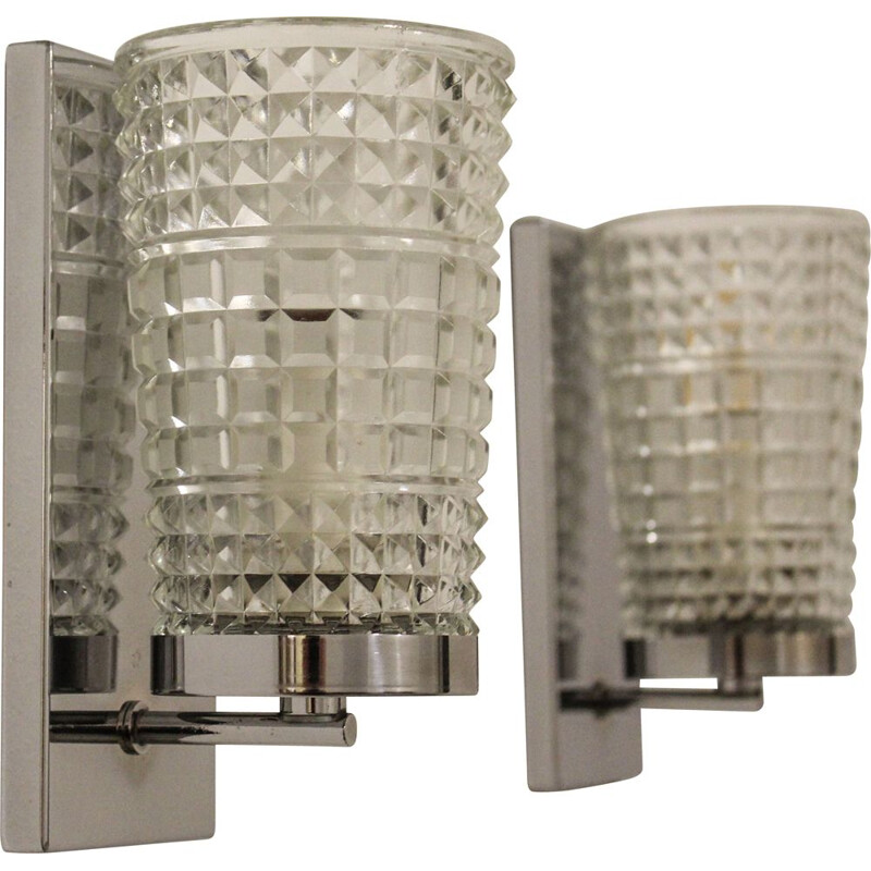 Pair of vintage wall lamps made of worked glass and chromium-plated metal , Italy 1970s