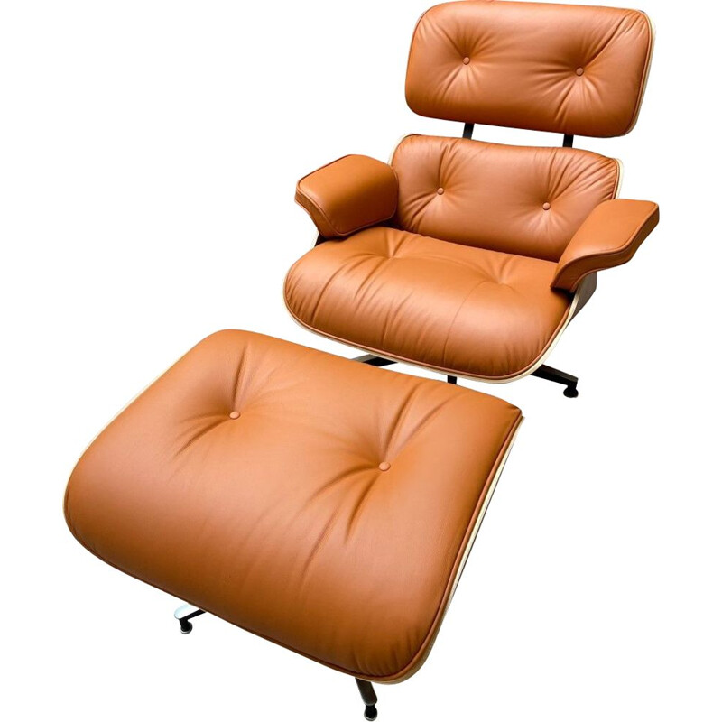 Vintage armchair and ottoman in cognac leather and rosewood by Charles Eames for Herman Miller, 2011