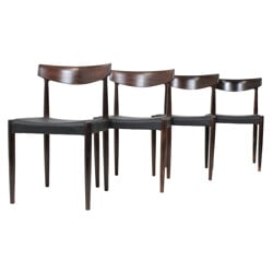 Set of 4 dining chairs in solid rosewood and black leather - 1960s